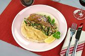 foto of tabouleh  - Middle Eastern lamb fillet on pita bread with hommus and tabouleh and lemon parsley - JPG