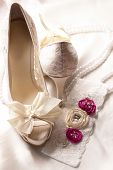 stock photo of garter  - Bridal shoes and lace garter close up - JPG