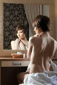 image of nearly nude  - Slim nude woman posing near mirror - JPG