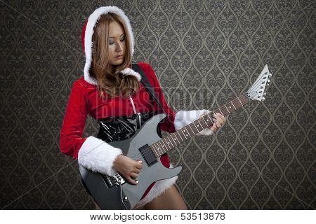 Lady in Mrs. Santa costume entertaining people and having fun.