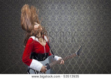 Guitarist in Mrs. Santa costume entertaining people and having fun.