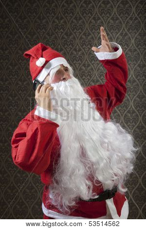 Santa is shouting someone on mobile phone.