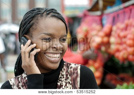 African Or Black American Woman Calling On Mobile Cellphone Telephone In Township