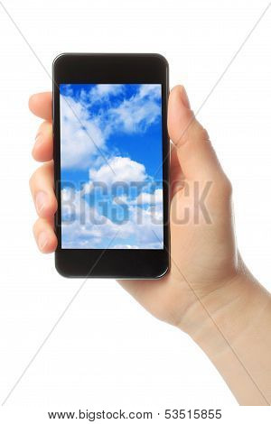 Woman hand holds smart phone with sky