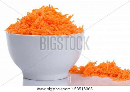 incised carrots in a white bowl isolated on white background
