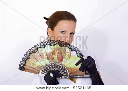 Young woman with colorful fan