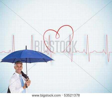 Composite image of businessman holding umbrella smiling at camera on white background