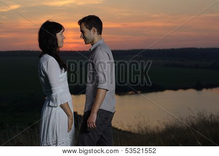 Couple at sunset and lake