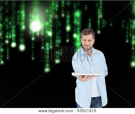 Composite image of happy man showing laptop to camera and smiling