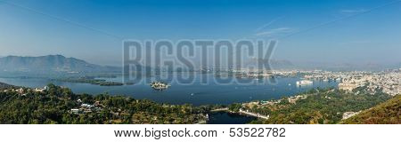 Aerial panorama of Lake Pichola and Udaipur with City palace, Lake Palace (Jag Niwas) and Jag Mandir (Lake Garden Palace).  Udaipur, Rajasthan, India