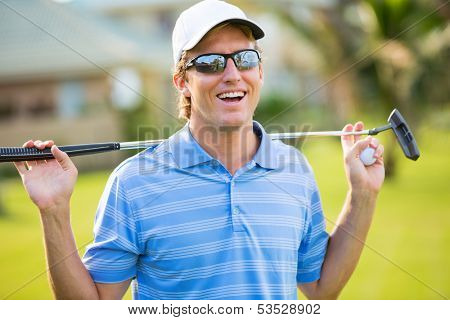 Athletic young man playing golf, Portrait of Golfer on Course with putter