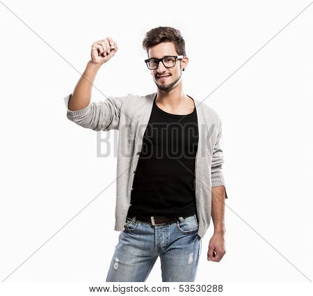 Portrait of a handsome young man wearing glasses and  writting something on a glass writeboard