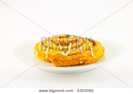 Cinnamon Bun On A White Plate
