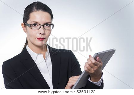 Confident Manageress Working On A Tablet