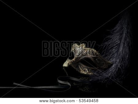 low key venetian mask with feather