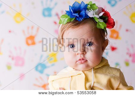Cute Little Baby With Flowers