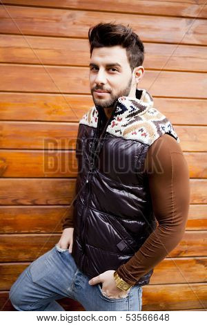 Young fashionable man on winter clothes
