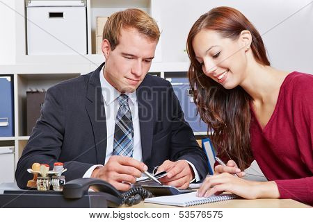 Woman at financial consultation with tax advisor in his office