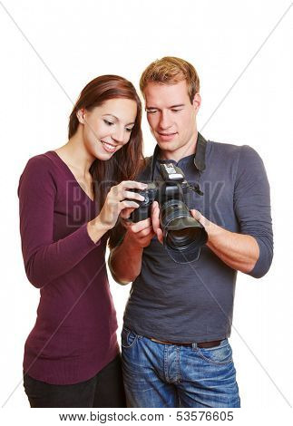 Photographer and model looking at images on the camera display
