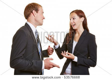 Two business people talking engaged to each other and using their hands