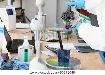 Preparation of paint for car painting in car body shop laboratory