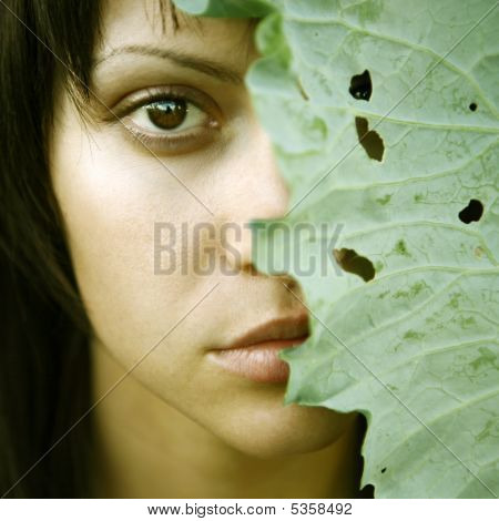 Beautiful Girl With Big Leaves On Head