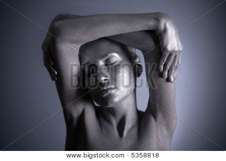 Nude Woman With Silver Make-up