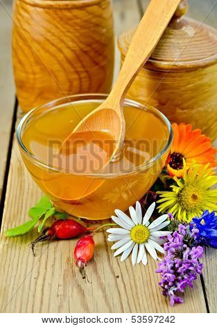 Honey With Flowers And Briar On The Board