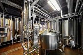 stock photo of cylinder  - Hall with brewing equipment - JPG