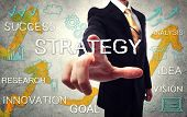 stock photo of handwriting  - Businessman pointing STRATEGY with handwriting cartoon background - JPG