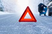stock photo of breakdown  - Car breakdown on a country road in winter - JPG