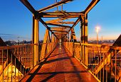 foto of skyway bridge  - Steel bridge for people at a night
