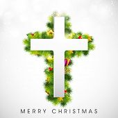 Merry Christmas celebration concept with white Christmas Cross on decorative grey background.