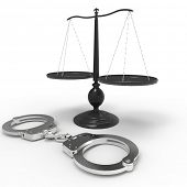 foto of handlock  - Scales of justice and handcuffs concept - JPG