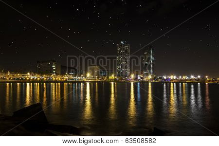 View Of The Promenade Of Barcelona By Night From The Sea
