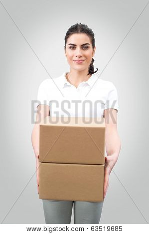 Young woman worker holding boxes