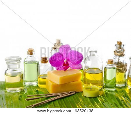spa supplies with oil,yellow candle on banana leaf