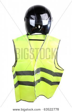Black motorcycle helmet and vest on a white background