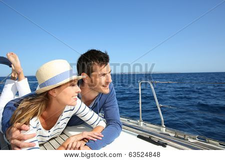 Couple enjoying cruising on sailboat