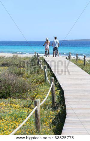 Couple riding bikes on Formentera Island