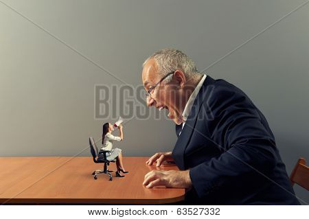 small businesswoman on the table and mad screaming man