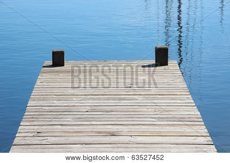 Bathing Jetty And Landing Stage For Boats With Blue Water