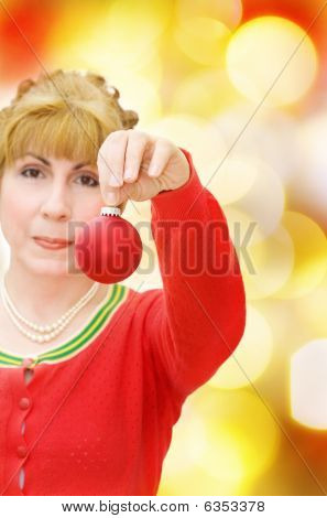 Merry Christmas with woman holding a red bauble