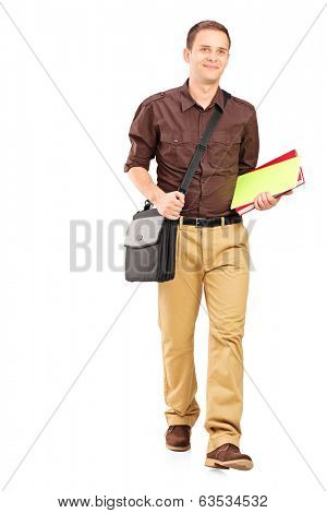 Full length portrait of a young man walking with books isolated on white background