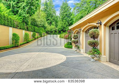 Luxury House. View Of Garage And Driveway