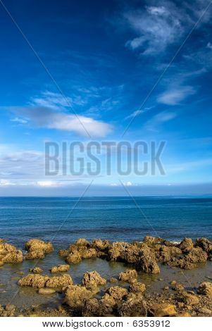 Landscape Of Golden Coral Reef Rock Coastline