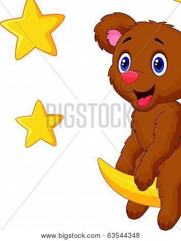 Baby bear cartoon sitting on the moon
