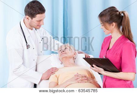 Doctors And Elderly Patient