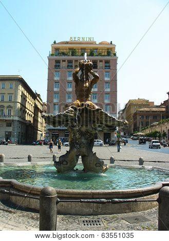 Fontana del Tritone in the front of Bernini Hotel at the Piazza Barberini in Rome