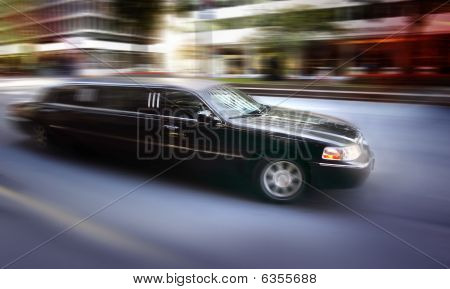Limosine Driving Down Street
